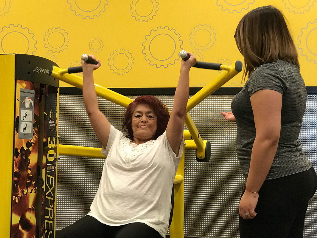 Woman excercising with her instructor