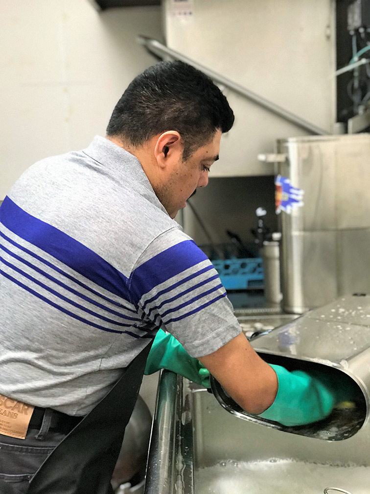 Man cleaning a kitchen