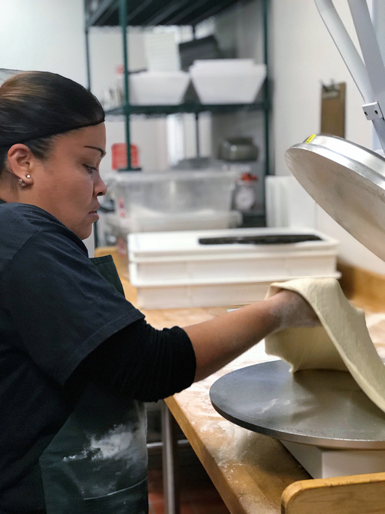 Female worker making a tortilla