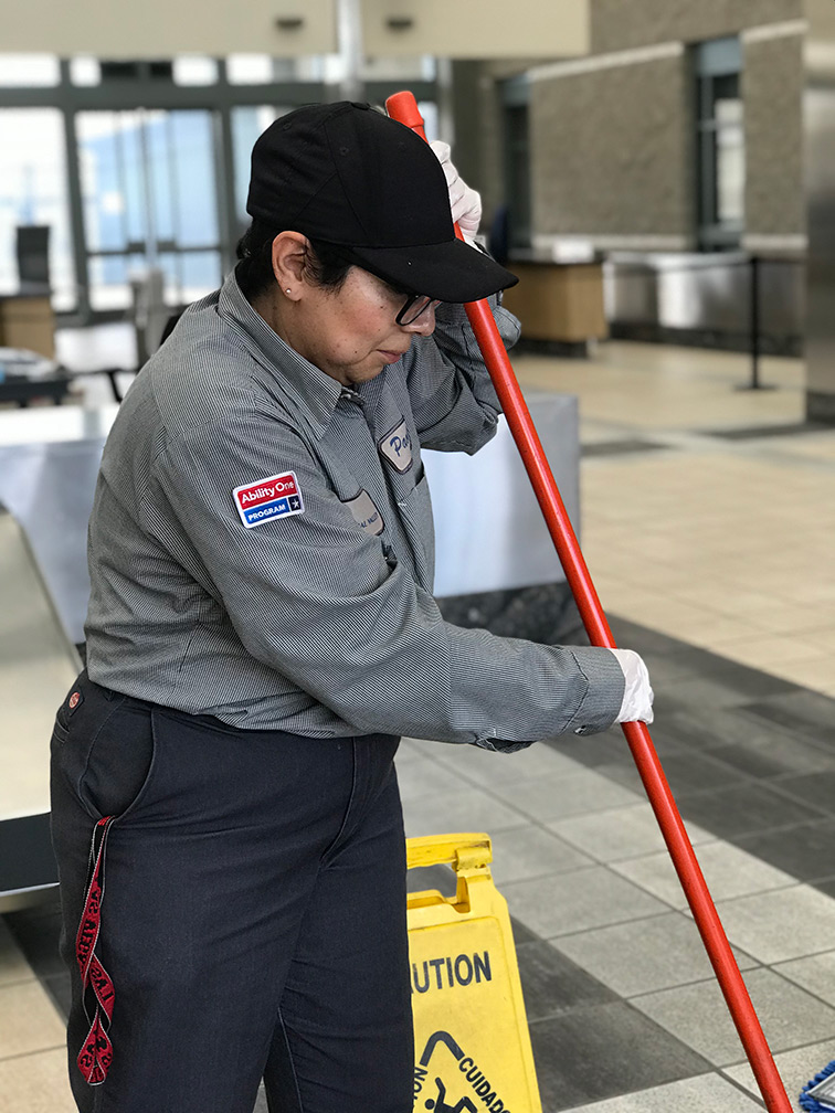 Female janitor cleaning the floor